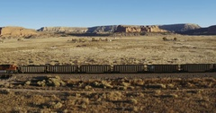 Aerial view of freight train in desert, Gallup, New Mexico, United States Stock Footage