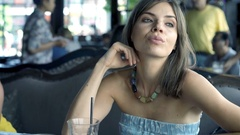 Sad, unhappy woman sitting in cafe, 4K Stock Footage