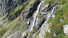 Aerial view of a waterfall in the mountains. Stock Footage