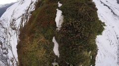 POV of a trail runner running up a snowy mountain, time-lapse. Stock Footage