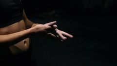 Woman dusting his hands with chalk powder in gym. Close up Handheld slowmotion Stock Footage
