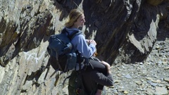 Tracking Shot Of Rock Climber Carrying Girlfriend On Shoulders Down The Trail Stock Footage