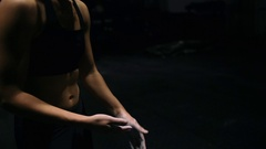 Woman dusting his hands with chalk powder in gym. Closeup Handheld slowmotion Stock Footage