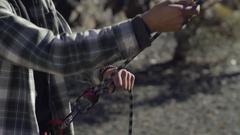 Outdoorsy Young Man Belays His Climbing Partner Stock Footage