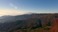 520 Aerial shot, gorgeous hills in the morning fog, sun high in the sky and.. Stock Footage