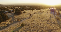 Man walking in park at sunset, Albuquerque, New Mexico, United States Stock Footage