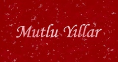 "Happy New Year text in Turkish ""Mutlu Yillar"" formed from dust and turns to dust Stock Footage"