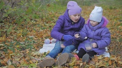 Children feed each other marmalade and cocoa. slow-motion Stock Footage