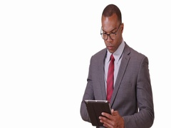 A black business professional poses for a portrait with his tablet and glasses Stock Footage