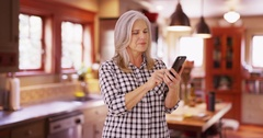 Lovely mid aged woman texting on cell phone device Stock Footage