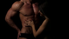 Sexy couple foreplay at home, woman pull down mans jeans, muscular body with abs Stock Footage