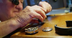 Close-up of horologist repairing a watch Stock Footage