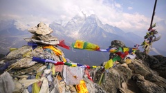 Ama Dablam mountain. Colourful prayer flags are waving on wind. Himalaya, Nepal Stock Footage