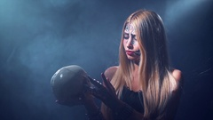 Woman spider and skull with Halloween face art Stock Footage