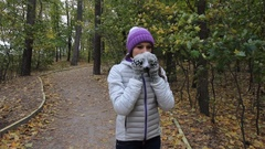 Sick girl is coughing in the autumn park Stock Footage