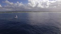 Sailing yacht and island coast, aerial shot Arkistovideo