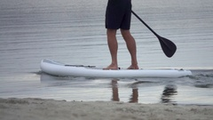 Extreme close up detail view of a man paddling his SUP stand-up paddleboard. Stock Footage