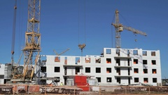 A construction crane delivers the concrete slab Stock Footage