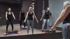 Female artist trained in the gym with exercise equipment in the mirror Stock Footage