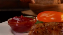 Grilled sausages with ketchup and vegetables Stock Footage