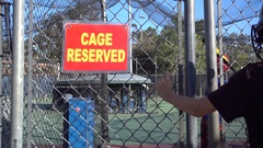 Cage Reserved sign at a baseball batting cage, super slow motion. Stock Footage