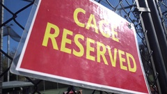 Cage Reserved sign at a baseball batting cage. Stock Footage