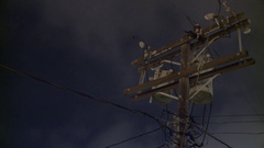 Time Lapse of a Telephone Pole / Power Line on a Cloudy Night Stock Footage
