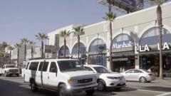 White van on Hollywood Boulevard and La La Land Marshall's Souvenir store LA Stock Footage