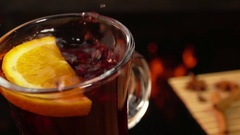 Asterisk anise falls from above in a nice mug of mulled wine Stock Footage