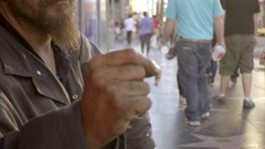 Homeless man flicking joint with finger street Hollywood Boulevard Los Angeles Stock Footage