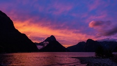Vibrant sunset over Milford Sound, South Island, New Zealand Stock Footage