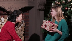 Foolish girlfriends having fun with presents at home Stock Footage