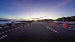 Sunset drivelapse on motorway into Wellington, New Zealand Stock Footage