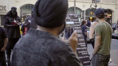 Actor dressed in Frank N Furter costume protesting Black Israelites in Hollywood Stock Footage