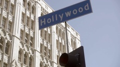 Hollywood sign over traffic light panning to Hollywood Boulevard street LA Stock Footage