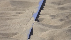 Details of the lines on a pro beach volleyball court. Stock Footage