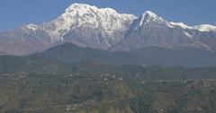 Huge mountain range rises to blue sky Stock Footage