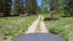POV view of a 4x4 vehicle driving off-road on a dirt road. Stock Footage