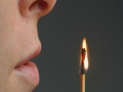 Woman Blows a Matchstick Stock Footage