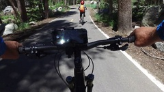 POV of a man riding his mountain bike on a singletrack dirt trail in the woods. Stock Footage