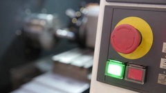 Red button of control panel machine processing of metal, industrial background Stock Footage
