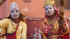 Young Girls dressed as Hindu goddess with make-up and traditional clothing at th Stock Footage