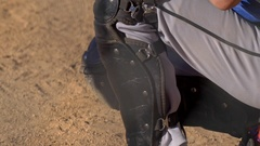 Close up of a catcher playing in a little league baseball game. Stock Footage