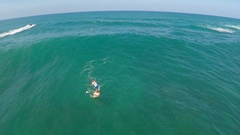 Aerial view of a wipeout sup stand-up paddleboard surfing in Hawaii. Stock Footage