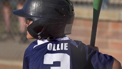 A boy at bat playing in a little league baseball game, slow motion. Stock Footage