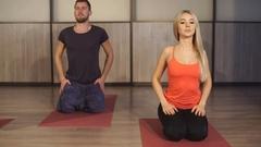 Group of people making yoga exersice Stock Footage