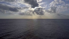AI Flying Up High Ocean Clouds Sun Aerial Stock Footage