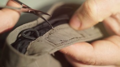 Close-up Tailor repairing clothes Stock Footage