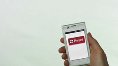 Mobile phone - reset button Stock Footage