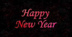 Happy New Year text formed from dust and turns to dust horizontally on black Stock Footage